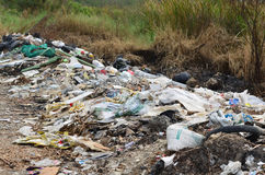 Illegal Roadside Dumping. In the forest stock photos