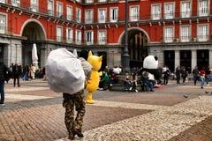 Illegal street vendors in La Plaza Mayor in Madrid. Madrid, Spain- March 7, 2019: Black illegal street vendors fleeing from the police in La Plaza Mayor in stock photos