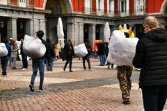Illegal street vendors in La Plaza Mayor in Madrid. Madrid, Spain- March 7, 2019: Black illegal street vendors fleeing from the police in La Plaza Mayor in stock images