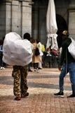 Illegal street vendors in La Plaza Mayor in Madrid. Madrid, Spain- March 7, 2019: Black illegal street vendors fleeing from the police in La Plaza Mayor in royalty free stock photo