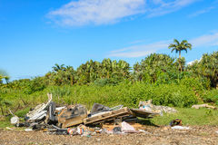 Illegal waste dump and tropical forest Royalty Free Stock Photo