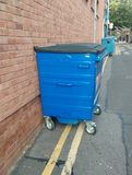 Illegally parked dumpsters. Rubbish bins parked on double yellow no parking lines Stock Photos