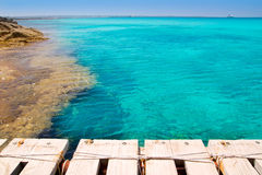 Illeta wooden pier turquoise sea Formentera Stock Photos
