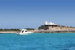 Illetes salt windmill from sea view Formentera Royalty Free Stock Image