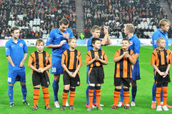 Illichivets footballers on the field with children Royalty Free Stock Images