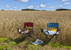 The Chairs of Spectators of Le Tour de France. Illiers-Combray,France- July 21st, 2012: Two chairs of spectators, full of promotionals materials are at the edge Royalty Free Stock Image