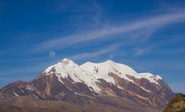 Illimani Mountain and Full Moon Royalty Free Stock Photos