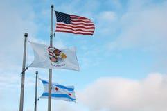 Illinois, Chicago, y bandera americana Imagen de archivo libre de regalías
