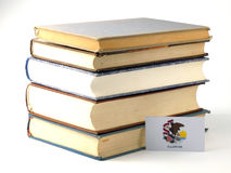 Illinois flag with pile of books  on white background Stock Photo