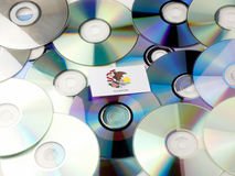 Illinois flag on top of CD and DVD pile isolated on white Royalty Free Stock Photography