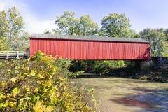 Illinois Red Covered Bridge. Built in 1863, Red Bridge, a covered bridge near Princeton, Illinois, spans Big Bureau Creek Stock Image