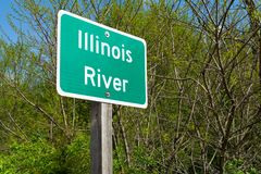 Illinois River sign. Illinois River street sign with woodland in background stock photos