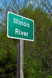 Illinois River sign. Illinois River street sign with woodland in background stock photo