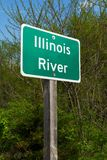 Illinois River sign. Illinois River street sign with woodland in background royalty free stock image