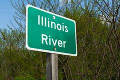 Illinois River sign. Illinois River street sign with woodland in background royalty free stock photos