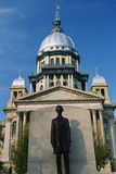 Illinois State Capitol Building. This is the State Capitol Building. It has a statue of Abraham Lincoln in front of it made of bronze. Illinois is known as the Stock Photography