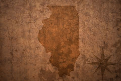 Illinois state map on a old vintage paper background. Illinois state map on a old vintage crack paper background Royalty Free Stock Image