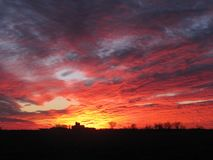 Brilliant winter sunset sky over Illinois dairy farm royalty free stock photography