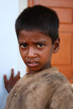 Illiterate and Poor Indian Kid. Poor uneducated boy from India. Photo taken near Chamundi Hills Temple, Mysore (South India Royalty Free Stock Photo