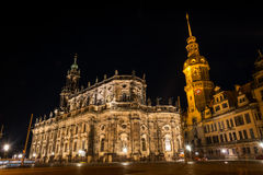 Illluminated Katholische Hofkirche in Dresden. Night view of the Cathedral of the Holy Trinity Hofkirche in Dresden, as seen from Theaterplatz square. Long Stock Photo