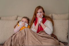 Illnes. Family flu season at home Stock Images