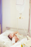 Illness asian boy lying on sickbed in hospital Stock Photos