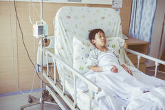 Illness asian child admitted in the hospital with infusion pump Royalty Free Stock Photos