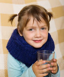 Illness baby girl in warm scarf Royalty Free Stock Image