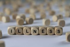Illness - cube with letters, sign with wooden cubes Stock Photos