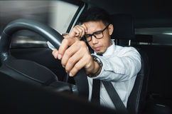 Illness, exhausted, disease, tired for overworked concept. Asian businessman having headache from migraine while he driving car Royalty Free Stock Photography