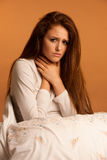Illness flu sore throat woman resting in bed.  royalty free stock images