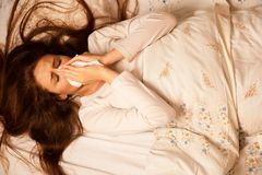 Illness flu - Young Woman Lying On Bed Infected With Allergy Blo Royalty Free Stock Image