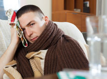 Illness guy in plaid stuping  towel Stock Image
