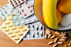 Illness or health. Large group of pills and blister packs stock photography