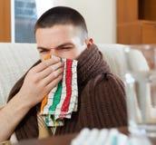 Illness man. Illness ordinary  man in warm plaid with handkerchief Stock Photo