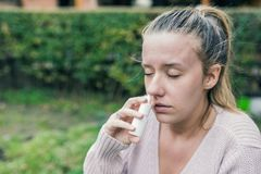 Illness And Sickness. Closeup Of Beautiful Woman Feeling Sick Dr. Ipping Nasal Drops In Blocked Nose. Portrait Female Sprays Cold And Sinus Medicine In Runny Stock Photos