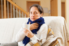 Illness woman. Doing home therapy royalty free stock image