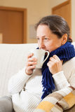Illness woman drinking hot tea Stock Image