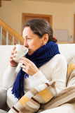 Illness woman drinking hot tea Royalty Free Stock Photography