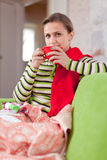 Illness woman drinking hot tea Stock Photos