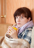 Illness woman drinking tea Stock Image