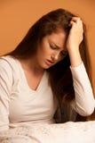 Illness woman having headache and feeling unweal Stock Photos