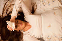 Illness woman having headache and feeling unweal Stock Images