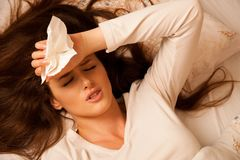 Illness woman having headache and feeling unweal Stock Photos