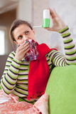 Illness woman with spray Royalty Free Stock Image