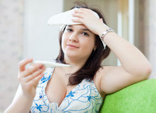 Illness woman with thermometer Stock Images