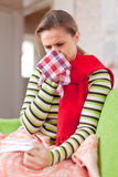 Illness woman uses handkerchief Royalty Free Stock Images