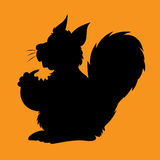 Illstration of the silhouette the character squirrel with a nut Royalty Free Stock Images