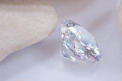 Illuminate diamond. With white stone royalty free stock images