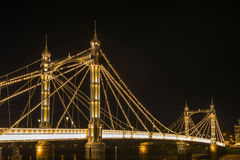 Illuminated Albert bridge at night, London, UK Stock Photography